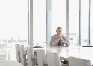 single lawyer solo practitioner at conference table alone
