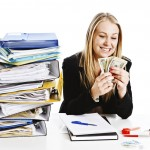 A paralegal counting her cash on a break from binder making.