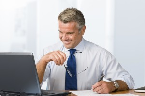 Smiling satisfied businessman working