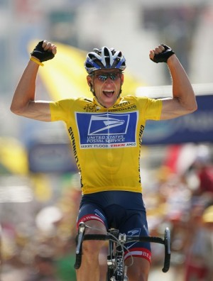 Lance Armstrong in happier days. Will he be this victorious in litigation disputes? (Photo by Robert Laberge/Getty Images)