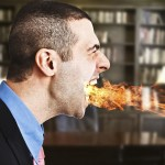 Angry businessman fire breathing lawyer