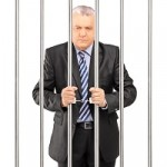 suit behind bars