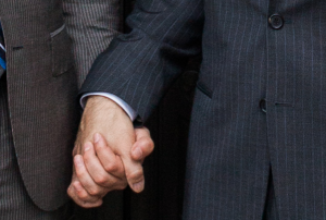 Grooms to be holding hands (photo by Tim Ryan Smith).