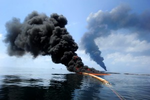 "100506-N-6070S-819 Gulf of Mexico (May 6, 2010) -- Dark clouds of smoke and fire emerge as oil burns during a controlled fire in the Gulf of Mexico. The U.S. Coast Guard working in partnership with BP PLC, local residents, and other federal agencies conducted the ""in situ burn"" to aid in preventing the spread of oil following the April 20 explosion on Mobile Offshore Drilling Unit Deepwater Horizon. (U.S. Navy photo by Mass Communication Specialist 2nd Class Justin Stumberg/Released)"
