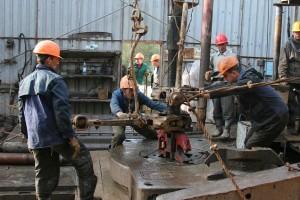 Men working oil