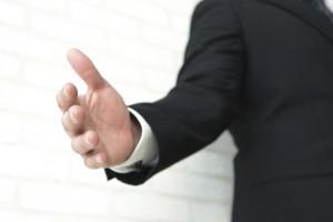 outreach handshake shaking hands