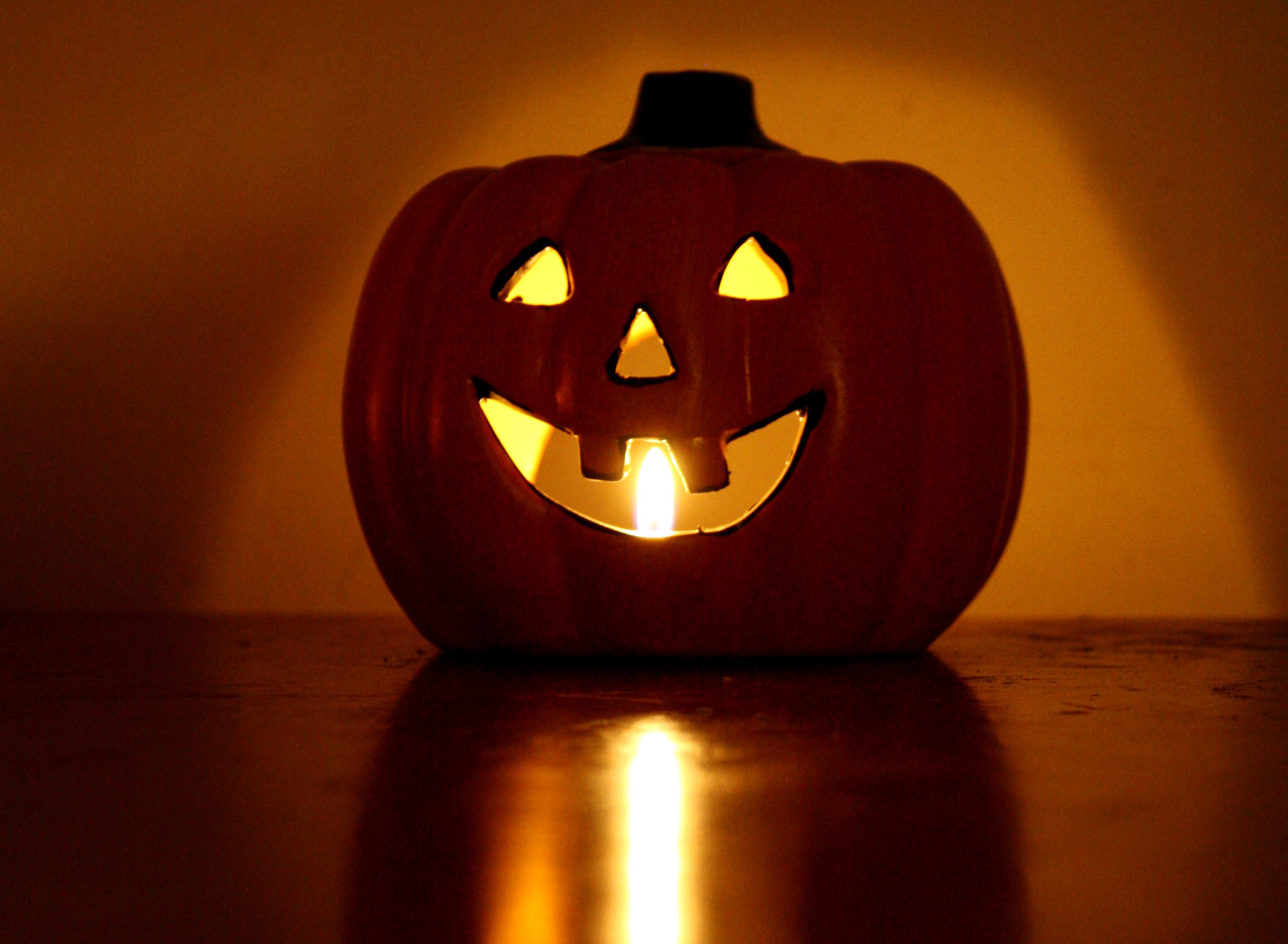 halloween-pumpkin-candle-with-burning-flame