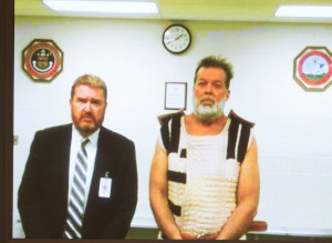 Colorado Springs Planned Parenthood shooting suspect Robert Dear appears via video during his advisement Monday, November 30, 2015, in Colorado Springs, Colo. At left is public defender Dan King. Pool Photo by Mark Reis, The Gazette