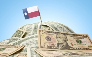 Flag of Texas sticking in american banknotes.(series)