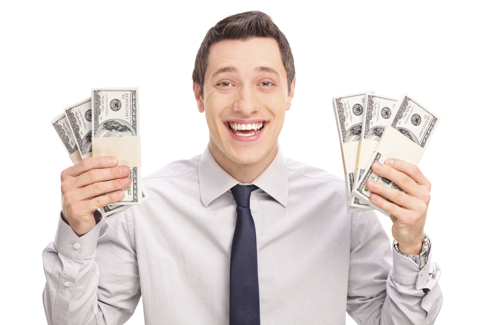 Joyful young man holding six stacks of money