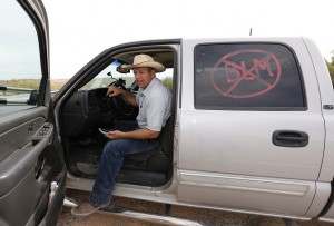 MESQUITE, NV - APRIL 11: Rancher Cliven Bundy's son, Ammon Bundy talks on a cell phone in his truck on April 11, 2014 west of Mesquite, Nevada. Bureau of Land Management officials are rounding up Cliven Bundy's cattle, he has been locked in a dispute with the BLM for a couple of decades over grazing rights. (Photo by George Frey/Getty Images