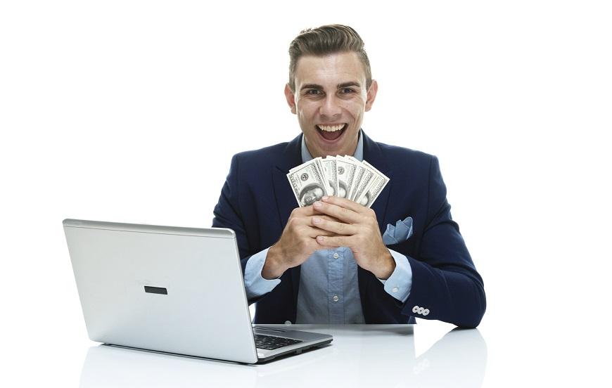 happy associate Biglaw bonus money tech laptop business casual