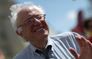 """WASHINGTON, DC - APRIL 20:  U.S. Sen. Bernie Sanders (I-VT) participates in a """"Don't Trade Our Future"""" march organized by the group Campaign for America's Future April 20, 2015 in Washington, DC. The event was part of the Populism 2015 Conference which is conducting their conference with the theme """"Building a Movement for People and the Planet.""""   (Photo by Win McNamee/Getty Images)"""