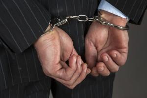 handcuff handcuffs businessman crime white collar criminal