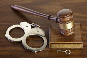 handcuffs justice gavel