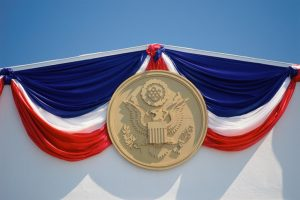 Red, white, and blue drapery with presidential seal