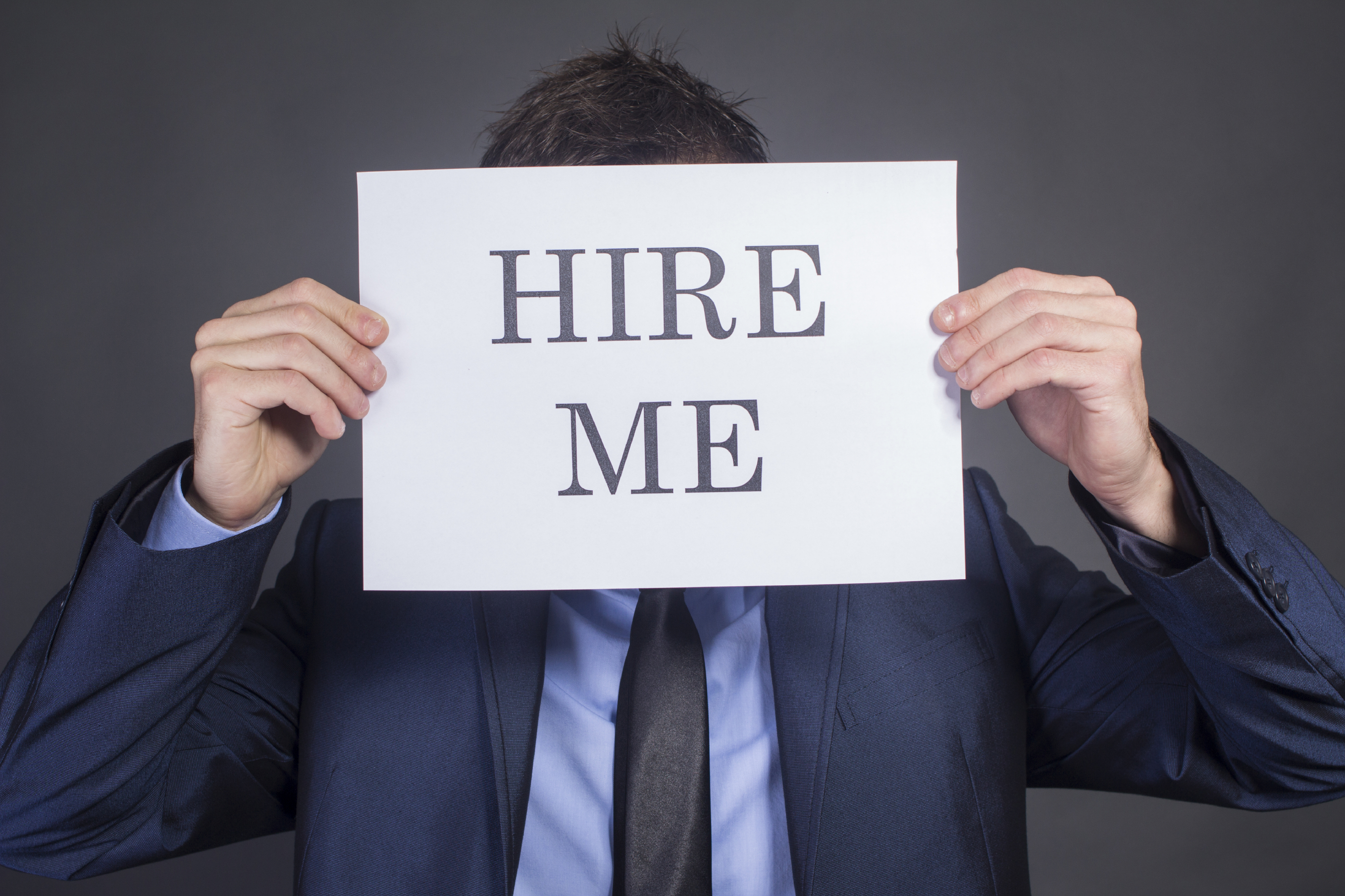 "Man Holding ""Hire Me!"""